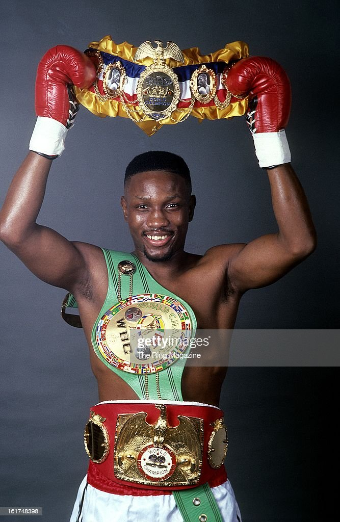 Pernell whitaker poses for a portrait with his belts in for The whitaker
