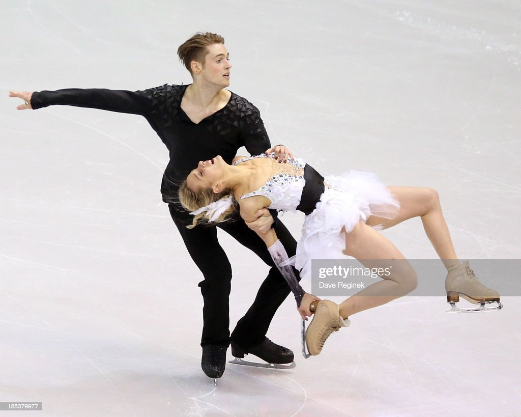 Pernelle Carron (R) and Lloyd Jones of France perform during the free dance of day two at Skate America at Joe Louis Arena on October 19, 2013 in Detroit, Michigan.