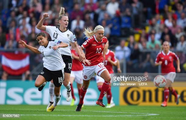 Pernille Harder of Denmark and Laura Feiersinger left and Virginia Kirchberger of Austria bduring the UEFA Women's EURO 2017 Semifinal match between...