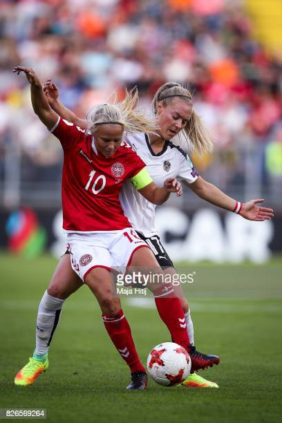 Pernille Harder of Denmark and Sarah Puntigam of Austria battle for the ball during the UEFA Women's Euro 2017 Semi Final match between Denmark and...