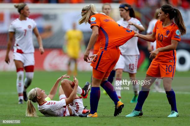Pernille Harder of Denmark lies on the floor picking up an injury during the Final of the UEFA Women's Euro 2017 between Netherlands v Denmark at FC...