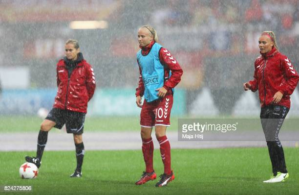 Pernille Harder of Denmark looks on as heavy rain falls during the UEFA Women's Euro 2017 Quarter Final match between Germany and Denmark at Sparta...