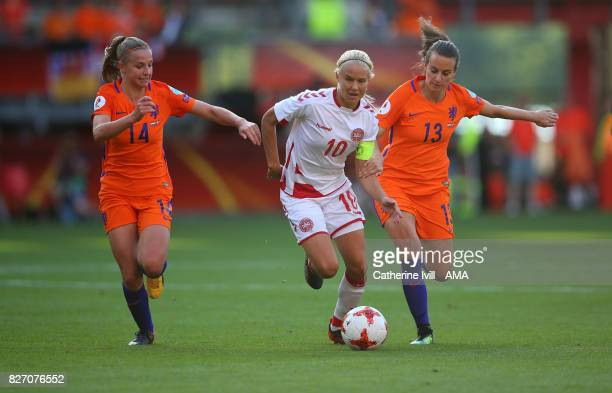 Pernille Harder of Denmark Women tries to get past Jackie Groenen and Renate Jansen of Netherlands Women during the UEFA Women's Euro 2017 final...