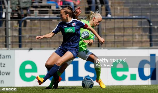 Pernille Harder of VfL Wolfsburg battles for the ball with Lia Waelti of Turbine Potsdam during the Allianz Women's Bundesliga match between Turbine...