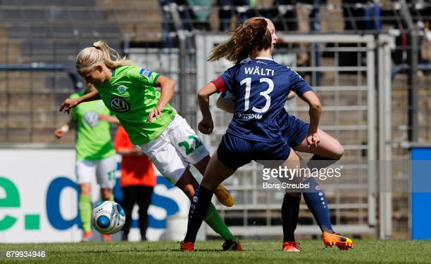 Pernille Harder of VfL Wolfsburg is fouled in the box by Lia Waelti of Turbine Potsdam during the Allianz Women's Bundesliga match between Turbine...