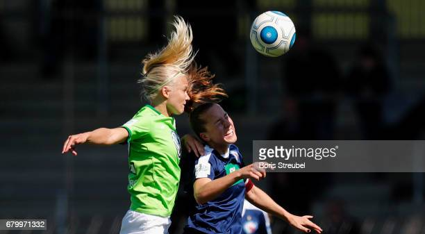 Pernille Harder of VfL Wolfsburg jumps for a header with Lia Waelti of Turbine Potsdam during the Allianz Women's Bundesliga match between Turbine...