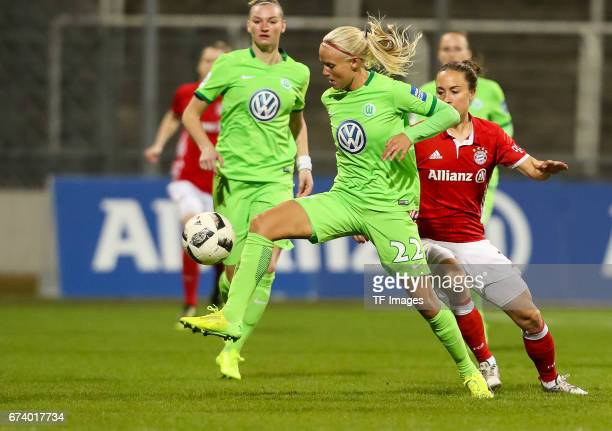 Pernille Harder of Wolfsburg and Gina Lewandowski of Munich battle for the ball during the Women's DFB Cup Quarter Final match between FC Bayern...