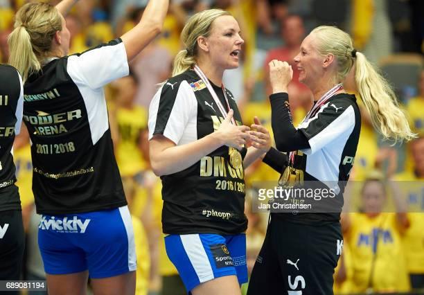 Pernille Holst Holmsgaard of Nykobing Falster Handbold and Goalkeeper Mette Iversen Sahlholdt of Nykobing Falster Handbold celebrate after the Primo...