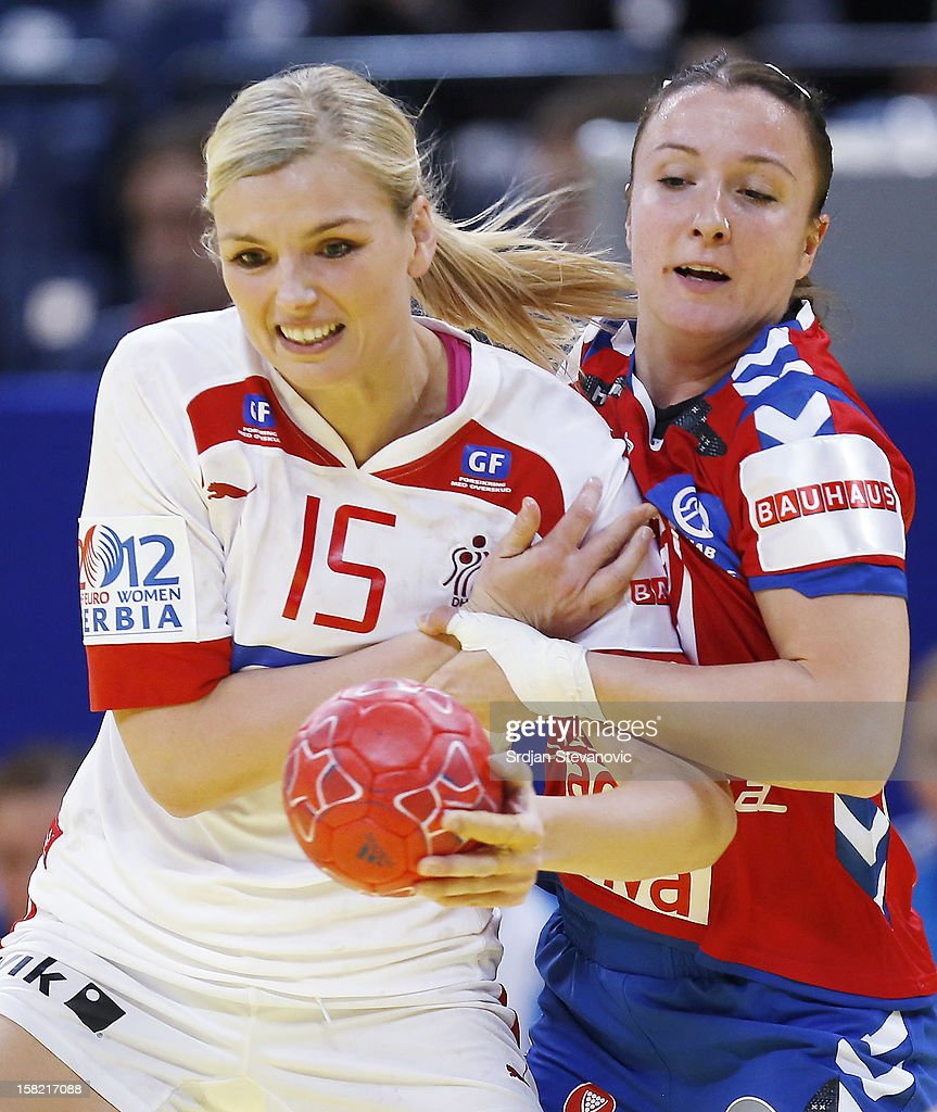 Pernille Holst Larsen (R) of Denmark is challenged by Katarina Krpez (R) of Serbia during the Women's European Handball Championship 2012 Group I main round match between Serbia and Denmark at Arena Hall on December 11, 2012 in Belgrade, Serbia.