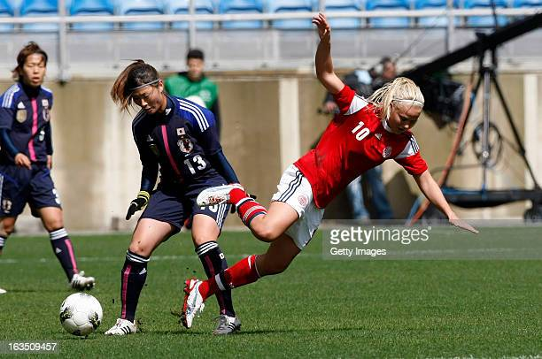 Pernille M Harder of Denmark challenges Rumi Utsugi of Japan during the Algarve Cup 2013 match between Denmark and Japan at the Algarve Stadium on...