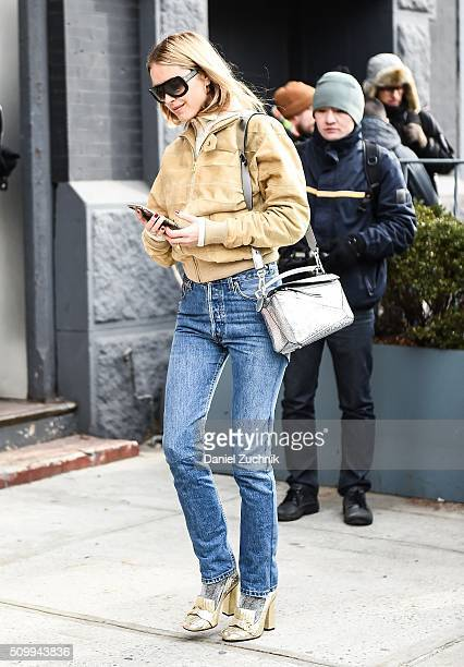Pernille Teisbaek is seen outside the Jason Wu show wearing blue jeans and a brown coat during New York Fashion Week Women's Fall/Winter 2016 on...
