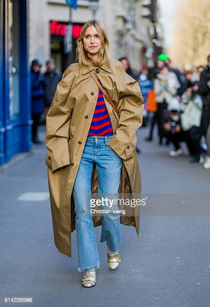 Pernille Teisbaek is wearing a Chloe bag a beige Vetements coat denim jeans and golden Gucci shoes outside Hermes during the Paris Fashion Week...