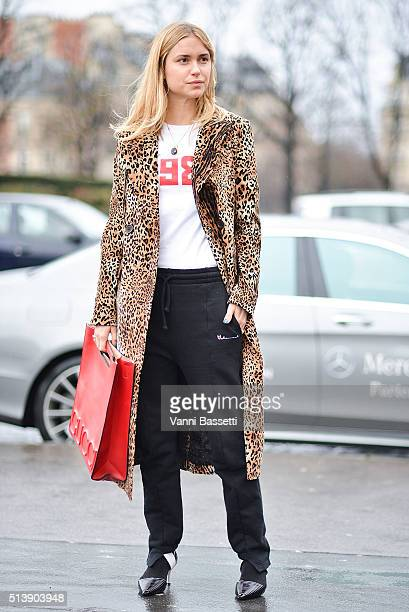 Pernille Teisbaek poses wearing Gosha Rubchinskiy tshirt Vetements pants and Gucci bag before the Haider Ackermann show at the Theatre de Chaillot...
