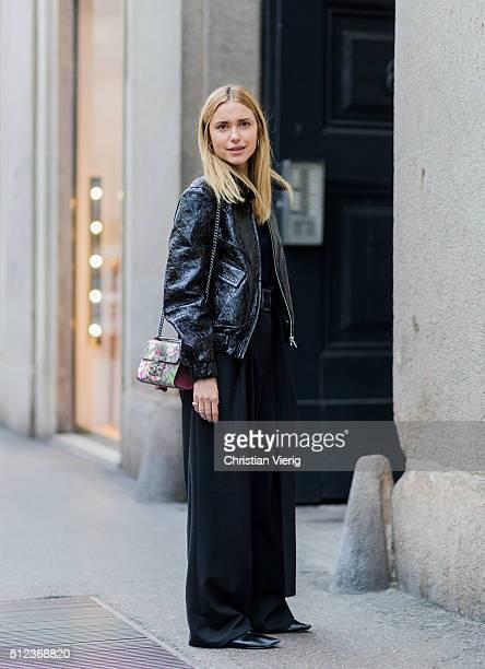 Pernille Teisbaek wearing a black Ganni jaclet seen outside Max Mara during Milan Fashion Week Fall/Winter 2016/17 on February 25 in Milan Italy