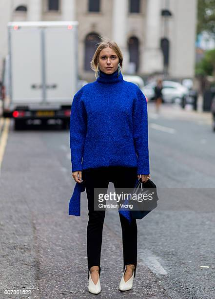 Pernille Teisbaek wearing a blue turtleneck sweater outside of the House of Holland during London Fashion Week Spring/Summer collections 2017 on...