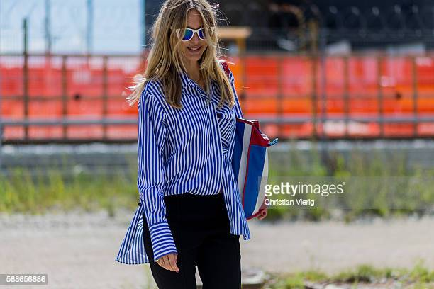 Pernille Teisbaek wearing a blue white striped button shirt from By Malene Birger outside By Malene Birger during the second day of the Copenhagen...