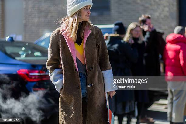 Pernille Teisbaek wearing a brown faux fur coat and a white knit cap seen outside Derek Lam during New York Fashion Week Women's Fall/Winter 2016 on...