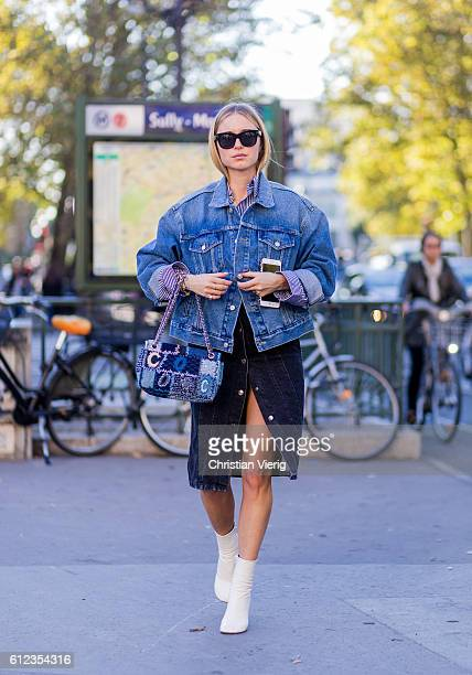 Pernille Teisbaek wearing a denim jacket and Chanel bag outside Hermes on October 3 2016 in Paris France