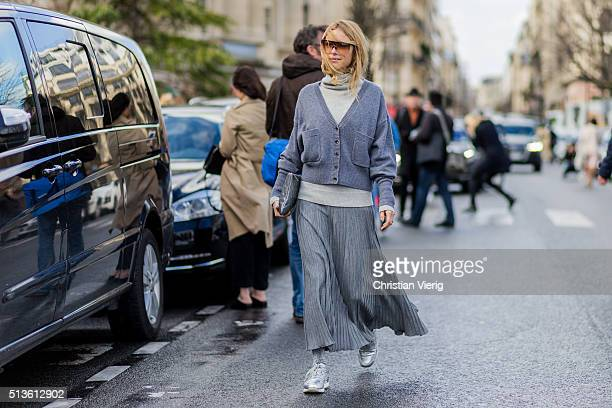 Pernille Teisbaek wearing a grey cardigan and skirt and a creme turtleneck and silver sneaker outside Chloe during the Paris Fashion Week Womenswear...