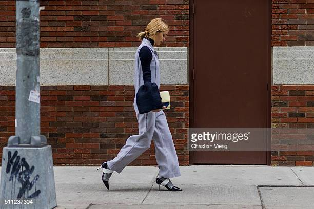 Pernille Teisbaek wearing a grey jumpsuit seen outside Boss during New York Fashion Week Women's Fall/Winter 2016 on February 17 2016 in New York City