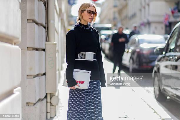 Pernille Teisbaek wearing a navy jumper outside Balmain during the Paris Fashion Week Womenswear Fall/Winter 2016/2017 on March 3 2016 in Paris France