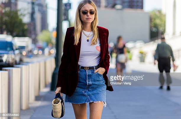 Pernille Teisbaek wearing a red velvet blazer Gucci belt and mini denim skirt outside Vera Wang on September 13 2016 in New York City