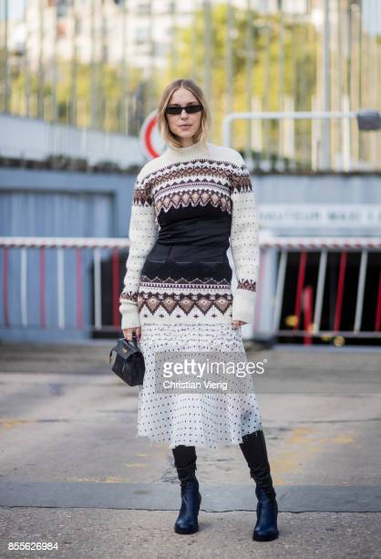 Pernille Teisbaek wearing knit black boots skirt with dots print is seen outside Loewe during Paris Fashion Week Spring/Summer 2018 on September 29...