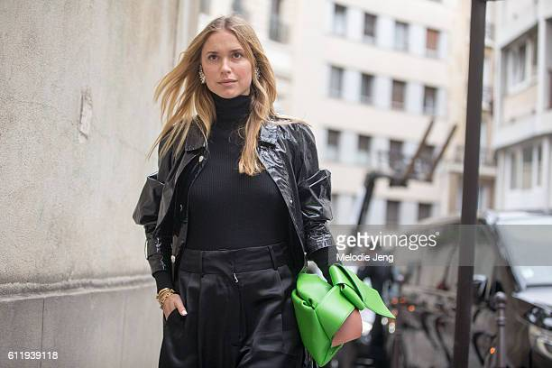 Pernille Teisbaek wears a black Isabel Marant jacket green Acne Studios purse and Miu Miu shoes outside the Acne Studios show on October 1 2016 in...