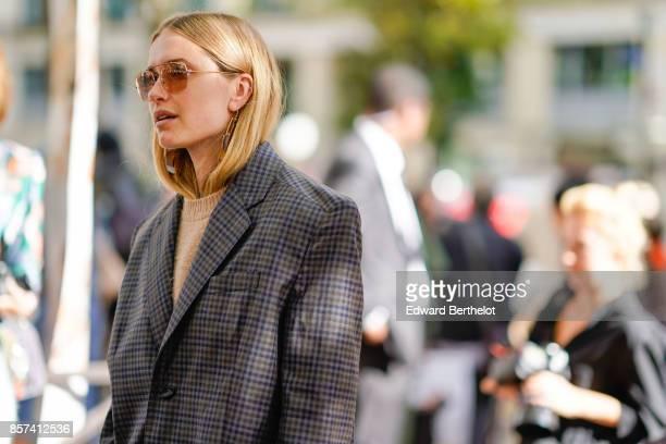Pernille Teisbaek wears a blazer jacket checkered outside Miu Miu during Paris Fashion Week Womenswear Spring/Summer 2018 on October 3 2017 in Paris...