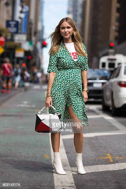 Pernille Teisbaek wears a green floral dress a Loewe bag and white booties outside the Tome show at Skylight Moynihan station on September 11 2016 in...