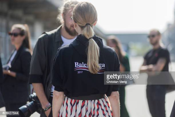 Pernille Teisbaek with a pigtail wearing a Balenciaga hoody striped skirt outside By Malene Birger on August 09 2017 in Copenhagen Denmark