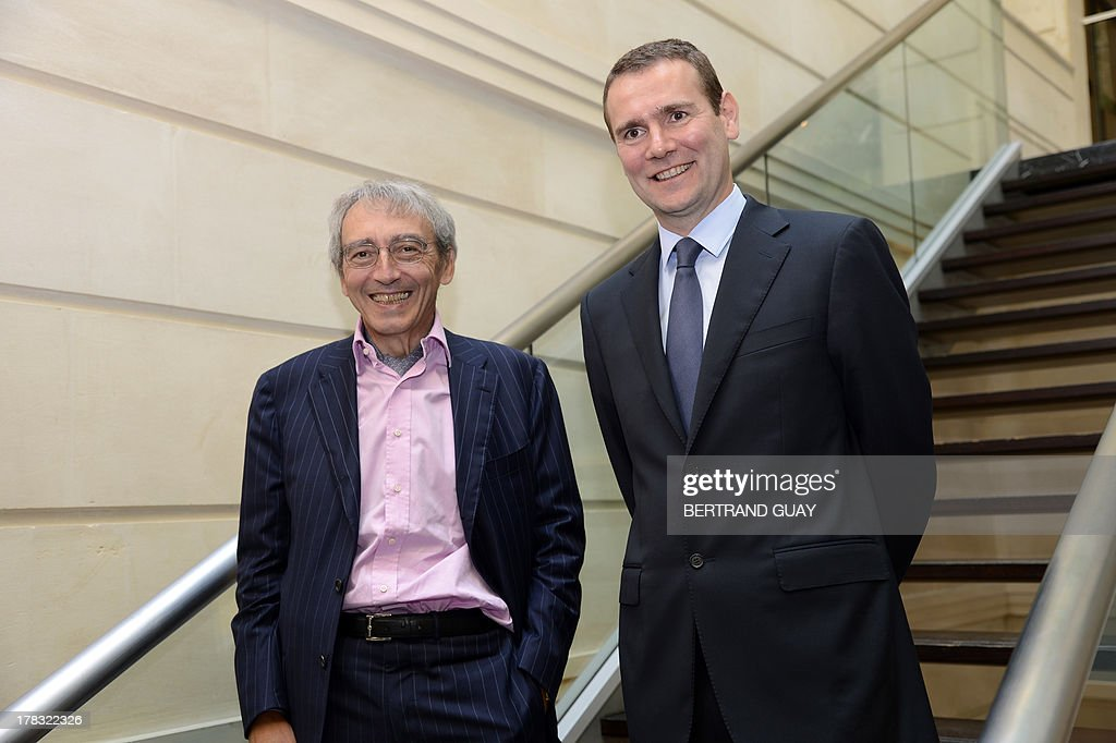 Pernod Ricard group's vice-President and general director Pierre Pringuet (L) and the group's managing director Alexandre Ricard pose prior to give a press conference to present the results for the 2012-2013 financial year, on August 29, 2013 in Paris. Pernod Ricard, the world No. 2 maker of wine and distilled spirits, on Thursday met its targets by posting a 3.0-percent rise in full-year net profits.