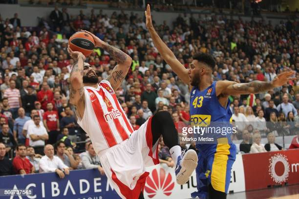 Pero Antic #12 of Crvena Zvezda mts Belgrade competes with Jonah Bolden #43 of Maccabi Fox Tel Aviv during the 2017/2018 Turkish Airlines EuroLeague...