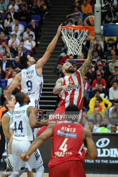 Pero Antic #6 of Olympiacos Piraeus in action during the Turkish Airlines EuroLeague Final game between Olympiacos Piraeus v Real Madrid at O2 Arena...