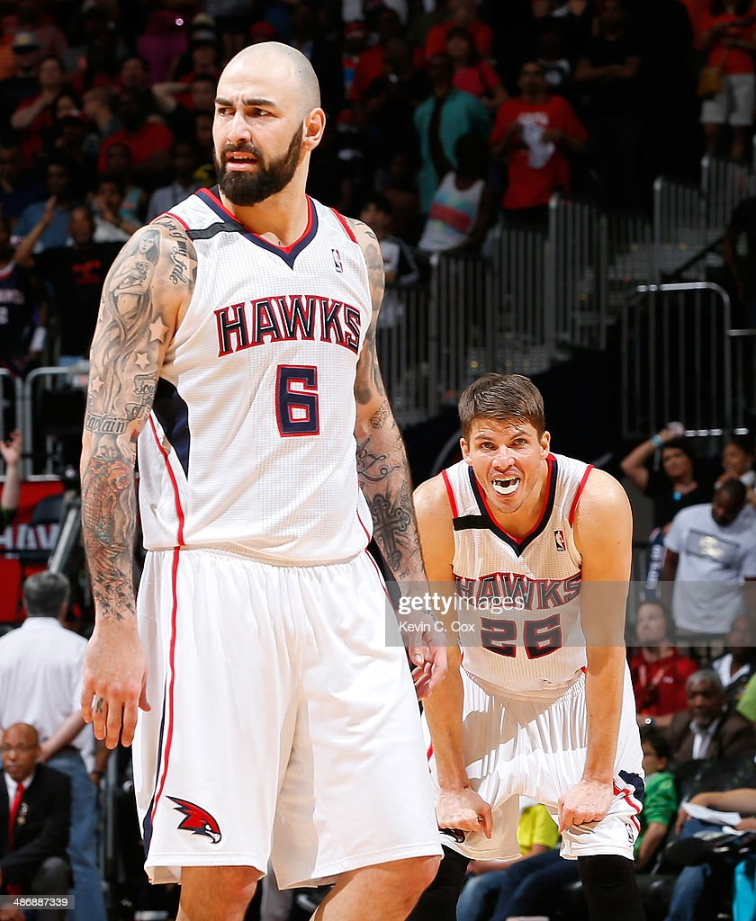Pero Antic #6 and <a gi-track='captionPersonalityLinkClicked' href=/galleries/search?phrase=Kyle+Korver&family=editorial&specificpeople=202504 ng-click='$event.stopPropagation()'>Kyle Korver</a> #26 of the Atlanta Hawks react to a foul called against DeMarre Carroll #5 in the final seconds of their 91-88 loss to the Indiana Pacers in Game Four of the Eastern Conference Quarterfinals during the 2014 NBA Playoffs at Philips Arena on April 26, 2014 in Atlanta, Georgia.