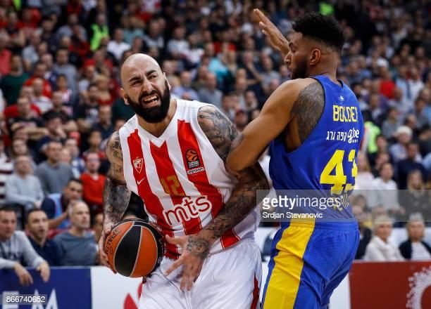 Pero Antic of Crvena Zvezda in action against Jonah Bolden of Maccabi during the 2017/2018 Turkish Airlines EuroLeague Regular Season game between...