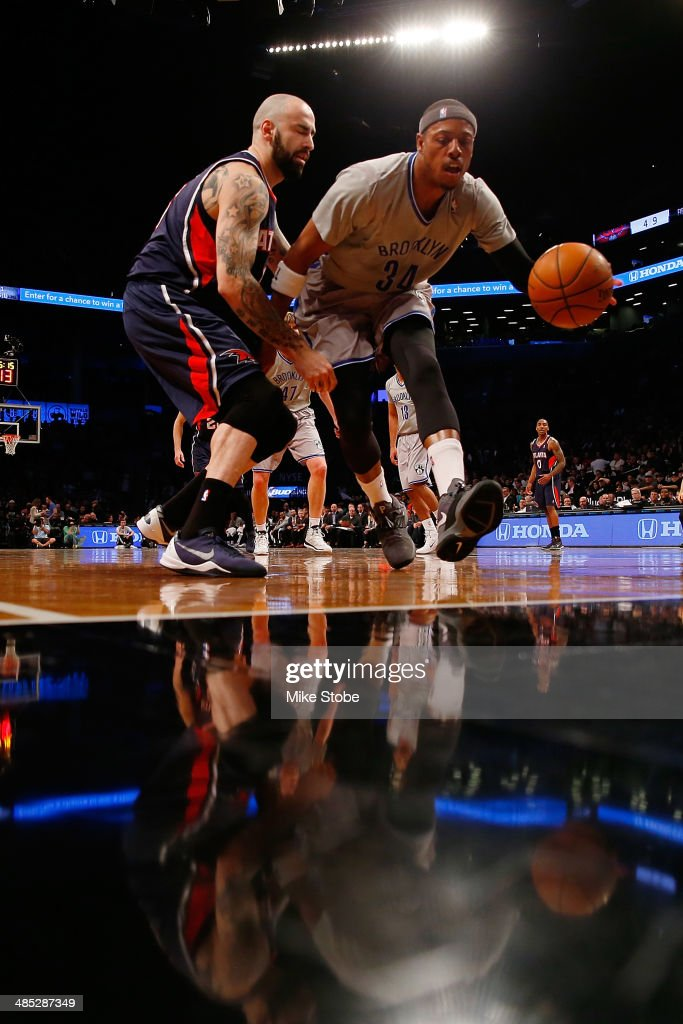 Pero Antic #6 of the Atlanta Hawks and <a gi-track='captionPersonalityLinkClicked' href=/galleries/search?phrase=Paul+Pierce&family=editorial&specificpeople=201562 ng-click='$event.stopPropagation()'>Paul Pierce</a> #34 of the Brooklyn Nets battle for the loose ball at Barclays Center on April 11, 2014 in New York City.