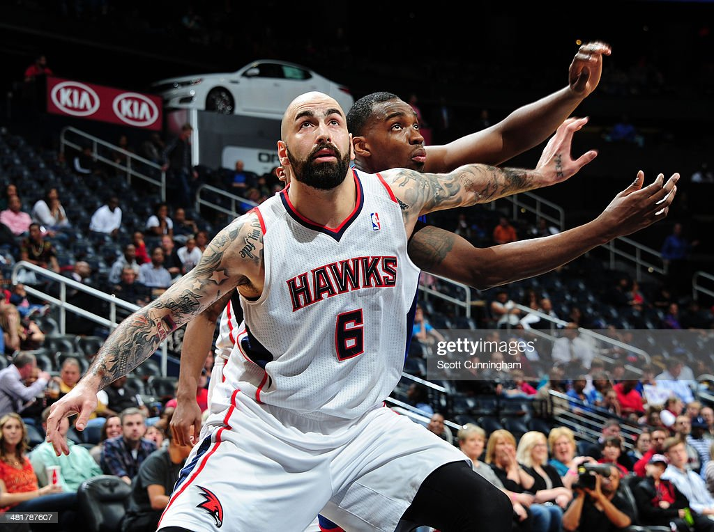 Pero Antic #6 of the Atlanta Hawks battles for a rebound against the Philadelphia 76ers on March 31, 2014 at Philips Arena in Atlanta, Georgia.