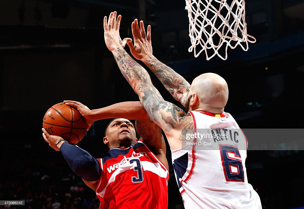 Pero Antic #6 of the Atlanta Hawks defends against Bradley Beal #3 of the Washington Wizards during Game One of the Eastern Conference Semifinals of the 2015 NBA Playoffs at Philips Arena on May 3, 2015 in Atlanta, Georgia.
