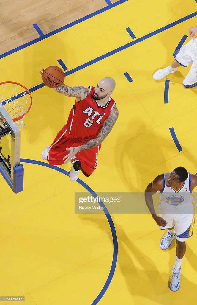 Pero Antic #6 of the Atlanta Hawks drives to the basket against the Golden State Warriors on March 7, 2014 at Oracle Arena in Oakland, California.