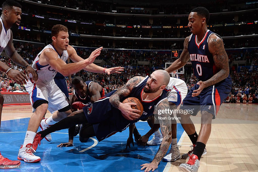 Pero Antic #6 of the Atlanta Hawks falls to the ground with a loose ball against the Los Angeles Clippers at Staples Center on March 8, 2014 in Los Angeles, California.