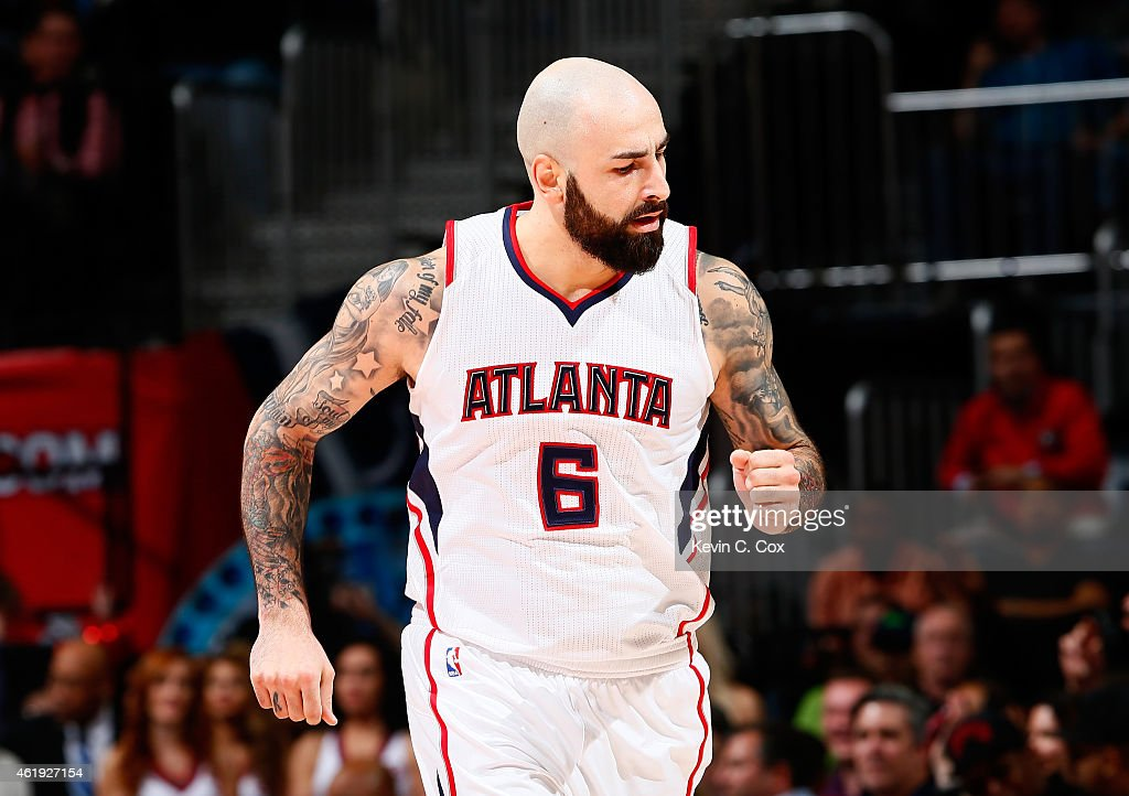 Pero Antic #6 of the Atlanta Hawks reacts after a three-point basket against the Indiana Pacers at Philips Arena on January 21, 2015 in Atlanta, Georgia.