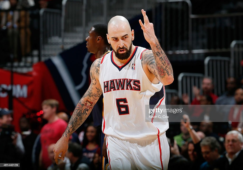 Pero Antic #6 of the Atlanta Hawks reacts after hitting a three-point basket against the Indiana Pacers at Philips Arena on January 8, 2014 in Atlanta, Georgia.