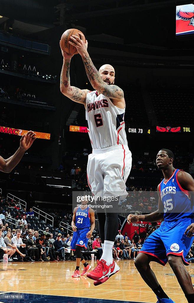 Pero Antic #6 of the Atlanta Hawks rebounds against the Philadelphia 76ers on March 31, 2014 at Philips Arena in Atlanta, Georgia.