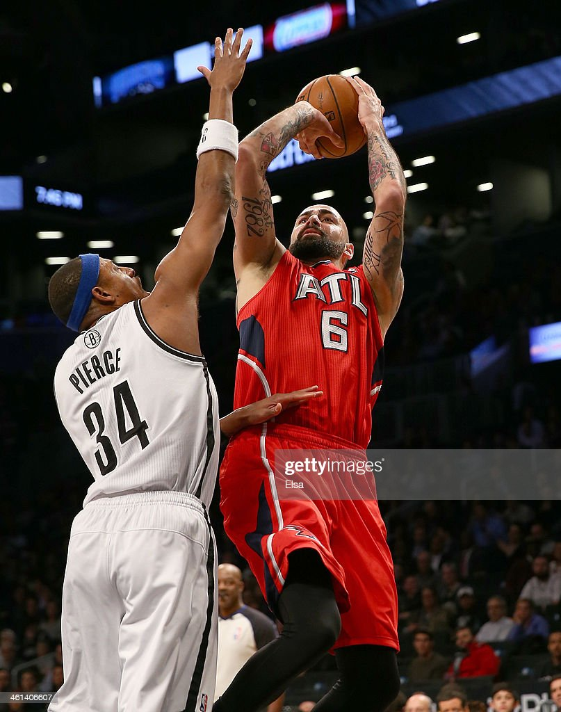 Pero Antic #6 of the Atlanta Hawks takes a shot as Paul Pierce #34 of the Brooklyn Nets defends at the Barclays Center on January 6, 2014 in the Brooklyn borough of New York City.