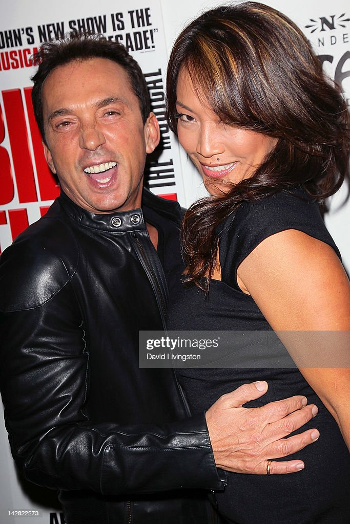 TV peronalities <a gi-track='captionPersonalityLinkClicked' href=/galleries/search?phrase=Bruno+Tonioli&family=editorial&specificpeople=742704 ng-click='$event.stopPropagation()'>Bruno Tonioli</a> (L) and <a gi-track='captionPersonalityLinkClicked' href=/galleries/search?phrase=Carrie+Ann+Inaba&family=editorial&specificpeople=637379 ng-click='$event.stopPropagation()'>Carrie Ann Inaba</a> attend the opening night of 'Billy Elliot' at the Pantages Theatre on April 12, 2012 in Hollywood, California.