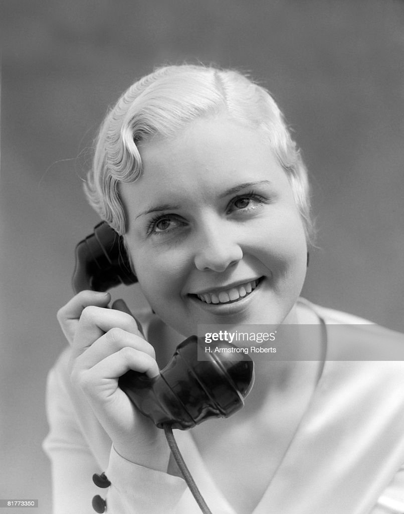 Peroxide Blonde Woman Smiling Talking On Telephone. : Stock Photo