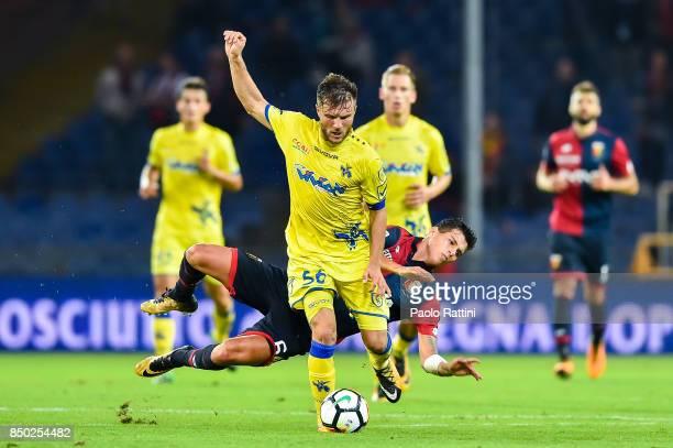 Perparim Hetemaj of Chievo Verona tackles Pietro Pellegri of Genoa during the Serie A match between Genoa CFC and AC Chievo Verona at Stadio Luigi...