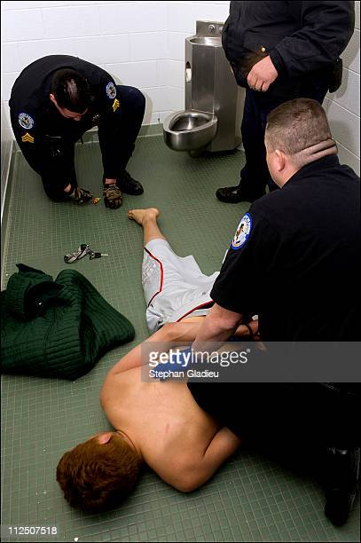 A perpetrator of domestic violence is undressed at the tribal jail and searched for illegal substances