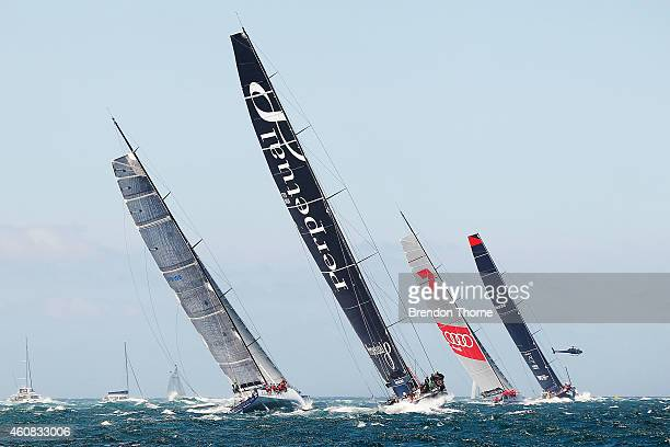 'Perpetual Loyal' follows 'Ragamuffin 100' 'Wild Oats XI' and 'Comanche' out to sea during the 2014 Sydney To Hobart on December 26 2014 in Sydney...